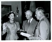 Dwight D. Eisenhower witnesses Frank K. Sanderson swearing in Mrs. Katherine G. Howard, as Deputy Administrator of the Federal Civil Defense Administration. June 29, 1953 [72-357-1]