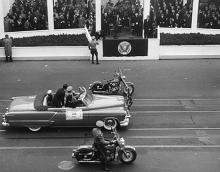 January 20, 1953 - The Inaugural Parade pauses with Kansas Governor Edward F. Arn with two motorcycle escorts as one of the escorts goes over to shake hands with DDE during the Inaugural Parade -