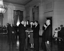 January 20, 1957 - Vice President Richard Nixon being sworn in by Senator William Knowland during the private ceremony held in the East Room of the White House