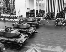 January 21, 1957 - Tanks pass the inaugural parade reviewing stand [72-2063-88]
