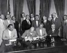 "Augus 30, 1954 -Dwight D. Eisenhower signs H.R. 9757, an act ""to amend the Atomic Energy Act of 1946."" [72-1031-1]"