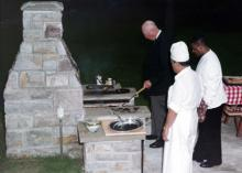 August 14, 1960 - Dwight D. Eisenhower cooking for friends at Camp David
