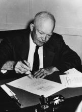 September 9, 1957 - Dwight D. Eisenhower signs the Civil Rights Act of 1957 (H.R. 6127) in his office at the naval base in Newport, Rhode Island