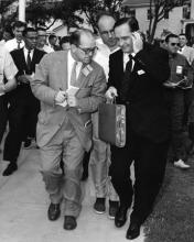 September 14, 1957 - Arkansas Governor Orval E. Faubus besieged by newsmen following his two hour conference with DDE at the naval base in Newport, Rhode Island