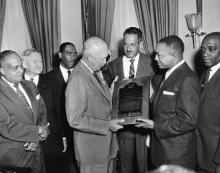 May 5, 1955 - John H. Sengstacke, publisher of the Chicago Defender, presents Dwight D. Eisenhower with the Robert Abbott Award [72-1348-1]