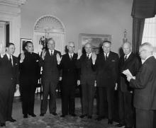January 3, 1958 - Dwight D. Eisenhower witnesses the swearing in ceremony for members of the Civil Rights Commission [72-2571-2]