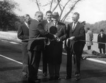 November 3, 1959 - Dwight D. Eisenhower participates in the ribbon cutting ceremony opening the new extension to the George Washington Memorial Parkway. [72-3261-3]