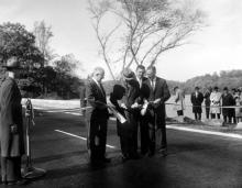 November 3, 1959 - Dwight D. Eisenhower participates in the ribbon cutting ceremony opening the new extension to the George Washington Memorial Parkway. [72-3261-4]
