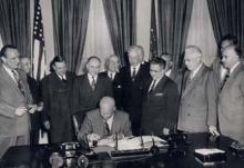 May 6, 1954 - Dwight D. Eisenhower signs H.R. 8127, An Act to amend and supplement the Federal-Aid Road Act approved July 11, 1916. [72-849-3]