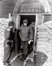 December 4, 1952 - Dwight D. Eisenhower leaves headquarters of the 5th Field Artillery Group during his visit to the headquarters of the 1st Republic of Korea's Capitol Division [77-18-872]