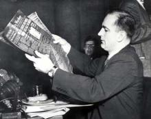"Senator Joseph R. McCarthy holding a photostat of the ""Daily Worker"" which includes an advertisement for a Communist front organization to which he alleged that Miss Dorothy Kenyon, a former State Department employee, had once joined."